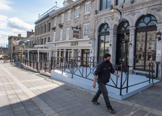 A major business lobby group in Quebec says a vaccine passport system could help revitalize downtowns decimated by the pandemic.  (Ryan Remiorz/The Canadian Press - image credit)