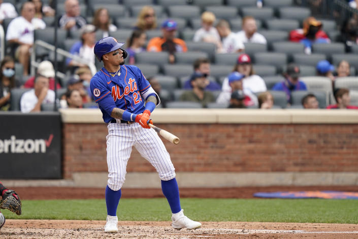 New York Mets' Javier Baez watches his two-run home run, also scoring Michael Conforto, during the fourth inning of a baseball game against the Washington Nationals, Sunday, Aug. 29, 2021, in New York. (AP Photo/Corey Sipkin)