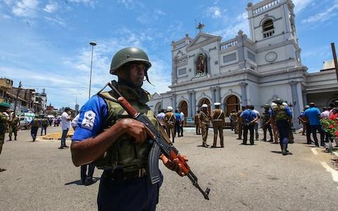 Sri Lankan security forces secure the area around St. Anthony's Shrine - Credit: Getty Images/Getty Images