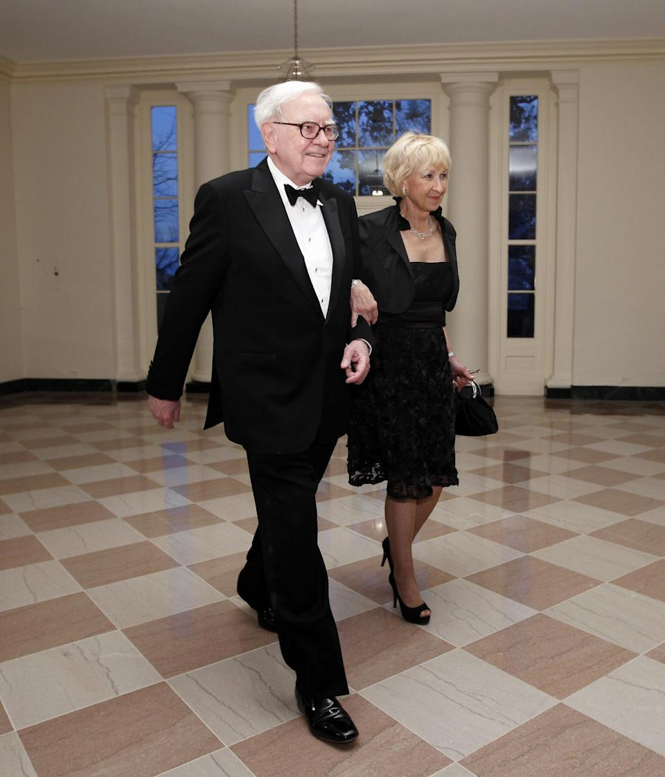 "FILE - In this March 14, 2012 file photo, Warren Buffett and Astrid M. Buffett arrive at the Booksellers area of the White House in Washington for the State Dinner hosted by President Barack Obama and first lady Michelle Obama for British Prime Minister David Cameron and his wife Samantha. A bill designed to enact President Barack Obama's plan for a ""Buffett rule"" tax on the wealthy would rake in just $31 billion over the next 11 years, according to an estimate by Congress' official tax analysts obtained by The Associated Press. (AP Photo/Charles Dharapak, File)"