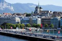 Cars drive on a bridge in front of the old town with the St. Pierre Cathedral in Geneva, Switzerland Monday, June 14, 2021. The lakeside city known as a Cold War crossroads and a hub for Swiss discretion, neutrality and humanitarianism, is set to return to a spotlight on the world stage as U.S. President Joe Biden and Russian President Vladimir Putin come to town for a summit on Wednesday, June 16. (AP Photo/Markus Schreiber)