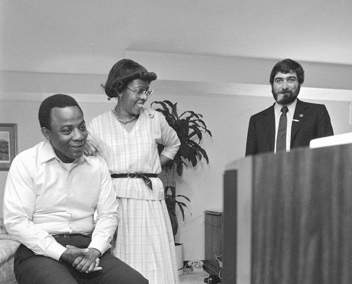 Pat Caddell, right, with W. Wilson Goode and his wife, Velma in 1983. (Photo: George Widman/AP)