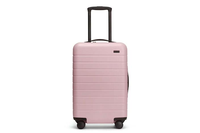 Pink hardside carry on suitcase
