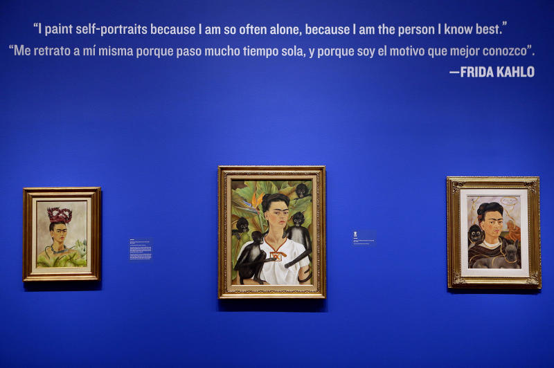 "This Feb. 8, 2013 photo shows self portraits by artist Frida Kahlo, titled from left, ""Self Portrait with Braids"", 1941, ""Self Portrait with Monkeys"", 1943, and ""Self Portrait with Monkey"", 1945, are displayed as part of the exhibition featuring the works of Kahlo and Diego Rivera, ""Frida & Diego: Passion Politics and Painting"", at the High Museum in Atlanta. The exhibit features more than 140 works, making it the largest exhibition of the couple's art ever displayed together. Atlanta's High will be the only U.S. venue for the exhibition, which opens Feb. 14 and runs through May 12. (AP Photo/David Goldman)"