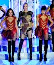 <p>Wearing an outfit by The Blonds with Christian Louboutin boots.</p>