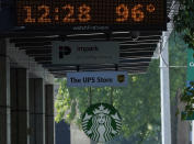 A parking garage sign shows the temperature at 96 degrees Fahrenheit in the shade, Monday, June 28, 2021, in downtown Seattle. Seattle and other cities broke all-time heat records over the weekend, with temperatures soaring well above 100 degrees Fahrenheit (37.8 Celsius). (AP Photo/Ted S. Warren)