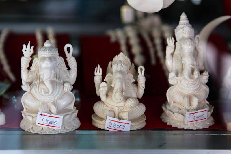 "In this photo taken on Feb. 7, 2013, Ganesh figures made of ivory are on display in a souvenir shop in famous ivory carving town of Nakhon Sawan, Thailand. Price tag on each worked piece rank between 30,000 – 35,000 Thai Baht. (US$1,000 -1,166). How to slow the slaughter and curb the trade in ""blood ivory"" will be among the most critical issues up for debate at the 177-nation Convention on International Trade in Endangered Species, or CITES, that gets under way Sunday, March 3, 2013 in Bangkok. (AP Photo/Sakchai Lalit)"