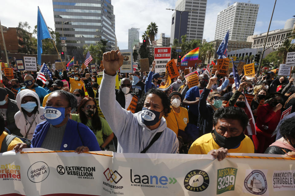 Demonstrators march to advocate protecting the voting results after former vice president and Democratic presidential candidate Joe Biden was announced as the winner over Pres. Donald Trump to become the 46th president of the United States in Los Angeles, Saturday, Nov. 7, 2020. (AP Photo/Ringo H.W. Chiu)
