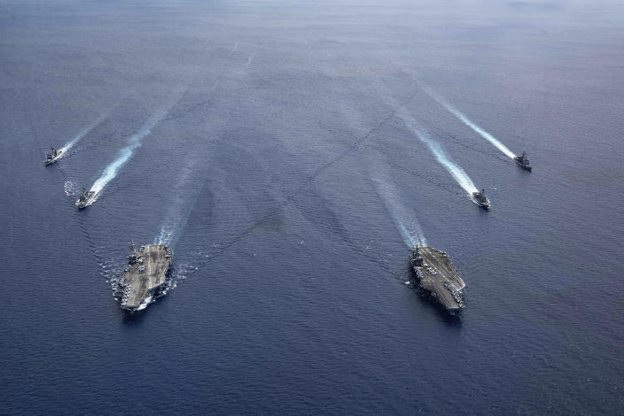 Image: The USS Ronald Reagan (CVN 76) and USS Nimitz (CVN 68) Carrier Strike Groups steam in formation, in the South China Sea (Mass Communication Specialist 3rd Class Jason Tarleton/U.S. Navy / AP)