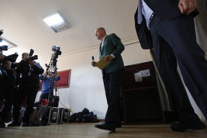 Turkey's President Recep Tayyip Erdogan, casts his ballot during local elections, in Istanbul, Sunday, March 31, 2019. Turkish citizens have begun casting votes in municipal elections for mayors, local assembly representatives and neighbourhood or village administrators that are seen as a barometer of Erdogan's popularity amid a sharp economic downturn.(AP Photo/Lefteris Pitarakis)