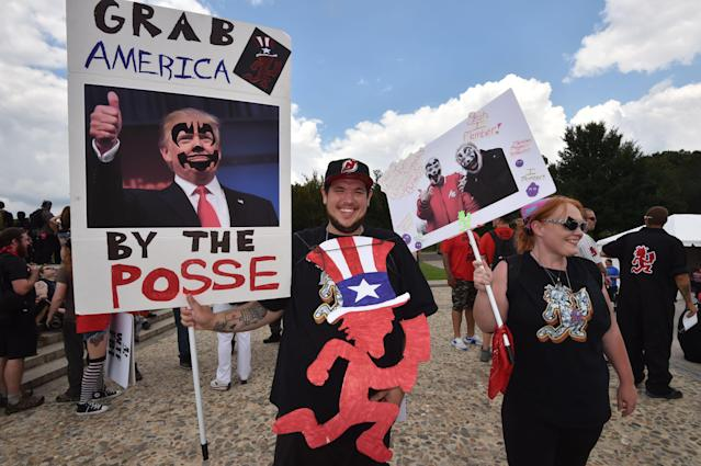 <p>Fans of the US rap group Insane Clown Posse, known as Juggalos, hold placards mocking US President Donald Trump during a protest on Sept. 16, 2017 near the Lincoln Memorial in Washington against a 2011 FBI decision to classify their movement as a gang. (Photo: Paul J. Richards/AFP/Getty Images) </p>