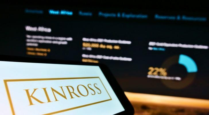 Cellphone with business logo of Canadian mining company Kinross Gold Corp. on screen in front of webpage.