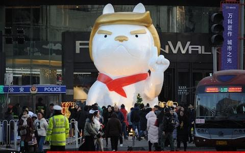 A dog sculpture in the style of Donald Trump outside a shopping mall in Taiyuan, December 2017 - Credit: VCG