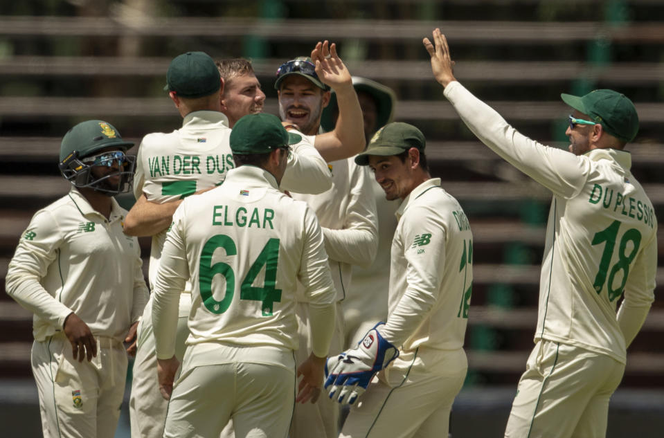 South Africa's bowler Anrich Nortje, middle facing camera, celebrates with teammates after taking a wicket of Sri Lanka's batsman Dushmantha Chameeraduring the 2nd Test cricket match between South Africa and Sri Lanka Wanderers stadium in Johannesburg, South Africa, Sunday, Jan. 3, 2021. (AP Photo/Themba Hadebe)
