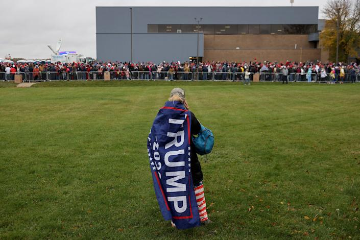 Thousands of supporters stand in line hoping to attend a campaign rally with President Donald Trump at Capital Region International Airport on Oct. 27, 2020, in Lansing, Mich.