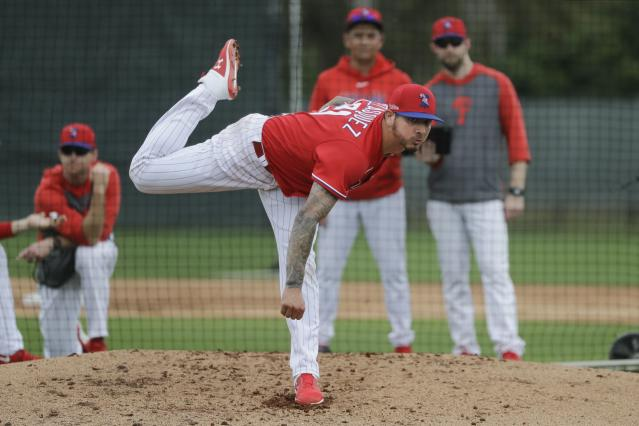 Philadelphia Phillies' Vince Velasquez delivers a pitch during a spring training baseball workout Wednesday, Feb. 19, 2020, in Clearwater, Fla. (AP Photo/Frank Franklin II)