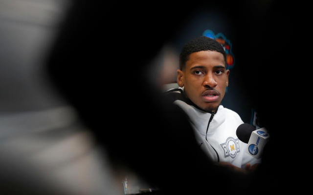 Michigan's Charles Matthews answers questions during a news conference for the championship game of the Final Four NCAA college basketball tournament, Sunday, April 1, 2018, in San Antonio. (AP Photo/Charlie Neibergall)