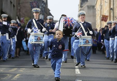 A boy marches with a flute band during a pro-Union rally in Edinburgh, Scotland, September 13, 2014. REUTERS/Paul Hackett
