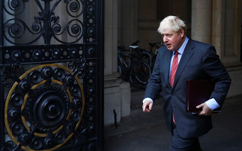 Boris Johnson leaves the Cabinet meeting - Reuters