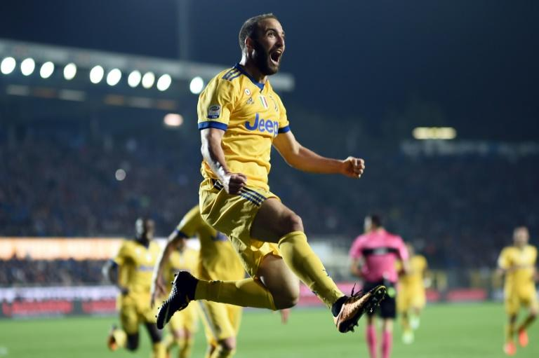 Juventus' Argentinian forward Gonzalo Higuain celebrates after scoring a goal during their Italian Serie A match against Atalanta, at the Atleti Azzurri d'Italia Stadium in Bergamo, on October 1, 2017