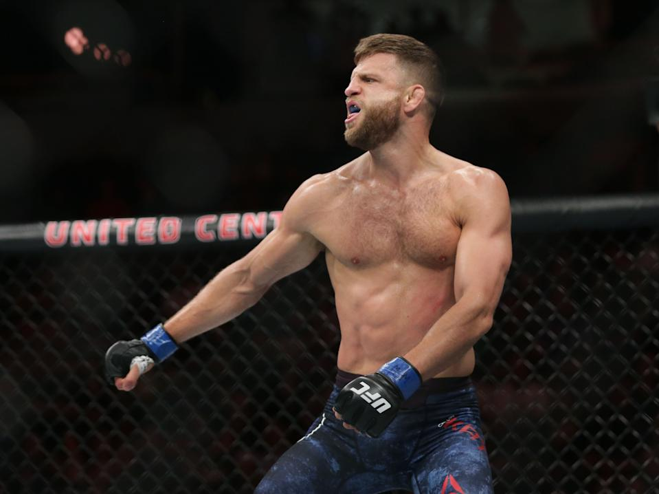 Jun 8, 2019; Chicago, IL, USA;  Calvin Kattar (blue gloves) defeats Ricardo Lamas (red gloves) during UFC 238 at United Center. Mandatory Credit: Jerry Lai-USA TODAY Sports
