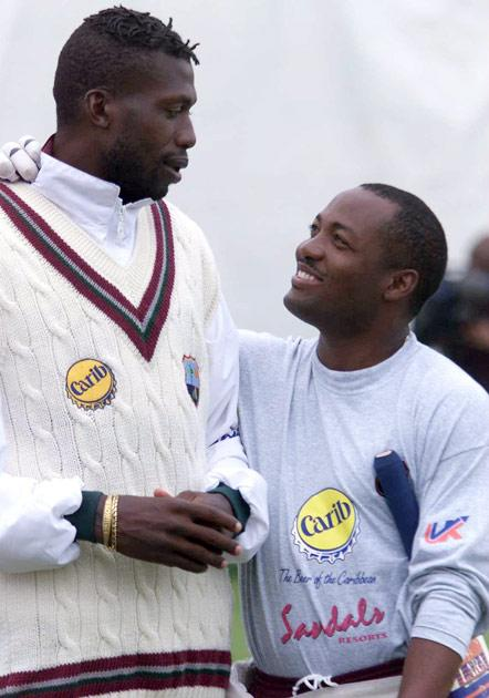 14 Jun 2000:  Brian Lara and Curtley Ambrose in relaxed mood ahead of the 1st Test against England during training at Edgbaston, Birmingham. Mandatory Credit: Laurence Griffiths/ALLSPORT
