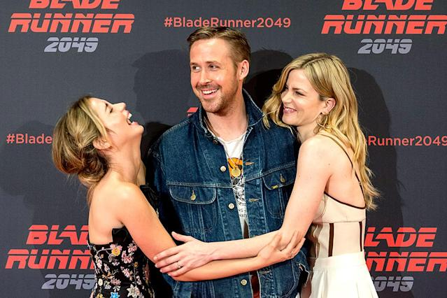 <p>Even other movie stars marvel at Eva Mendes's man! Can you tell that actors Ana de Armas and Sylvia Hoeks, two of Gosling's co-stars in the upcoming <i>Blade Runner 2049</i>, are fans? They were all about him while promoting the movie at CineEurope in Barcelona. (Photo: Robert Marquardt/Getty Images for Sony Pictures) </p>