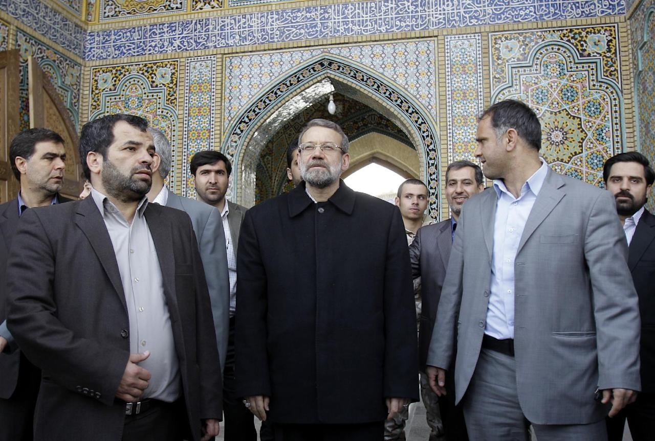 Iranian parliament speaker Ali Larijani, center, arrives at Masoumeh shrine to casts his ballot for the parliamentary elections in the city of Qom, 78 miles (125 kilometers) south of the Tehran, Iran, Friday, March 2, 2012. The balloting for the 290-member parliament is the first major voting since the disputed re-election of President Mahmoud Ahmadinejad in June 2009 and the mass protests and crackdowns that followed.(AP Photo/Kamran Jebreili)