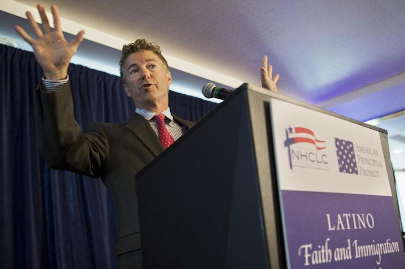 Sen. Rand Paul, R-Ky. gestures as he speaks at a forum on immigration organized by the Latino Partnership for Conservative Principles and the National Hispanic Christian Leadership Conference, Wednesday, June 12, 2013, at the Hyatt Regency Hotel in Washington. (AP Photo/Jacquelyn Martin)