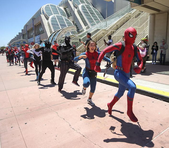 People dressed as Spider-Man dance in front of the San Diego Convention Center during Comic-Con in 2019.