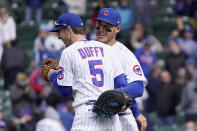 Chicago Cubs' Matt Duffy (5) and Anthony Rizzo celebrate their win over the Pittsburgh Pirates after a baseball game Friday, May 7, 2021, in Chicago. (AP Photo/Charles Rex Arbogast)