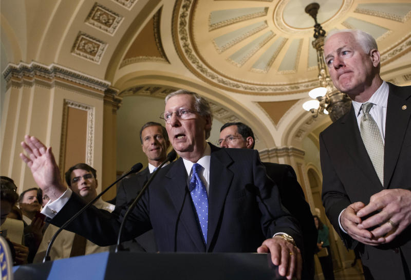 Senate Minority Leader Mitch McConnell of Ky., gestures as he and GOP leaders meet with reporters just off the Senate floor on Capitol Hill in Washington, Tuesday, Sept. 24, 2013, as lawmakers struggle with a stopgap spending bill that would prevent a partial government shutdown when the budget year ends next week. From left are, Sen. John Thune, R-S.D., McConnell, Sen. John Barrasso, R-Wyo., and Senate Minority Whip John Cornyn of Texas. (AP Photo/J. Scott Applewhite)