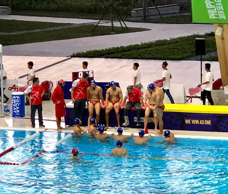 The Singapore water polo team during a time out in their 5-7 defeat by Indonesia at the SEA Games in the Philippines (PHOTO: Singapore Swimming Association/Facebook)