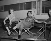 <p>The couple flashes their camera-ready smiles as they relax outside of their trailer on set. This same year, the couple launched their joint production company, Desilu Productions<em>. </em></p>