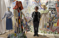 Designer Arthur Arbesser poses next to his creations as part of the women's Spring Summer 2022 collection, unveiled during the Fashion Week in Milan, Italy, Saturday, Sept. 25, 2021. (AP Photo/Antonio Calanni)