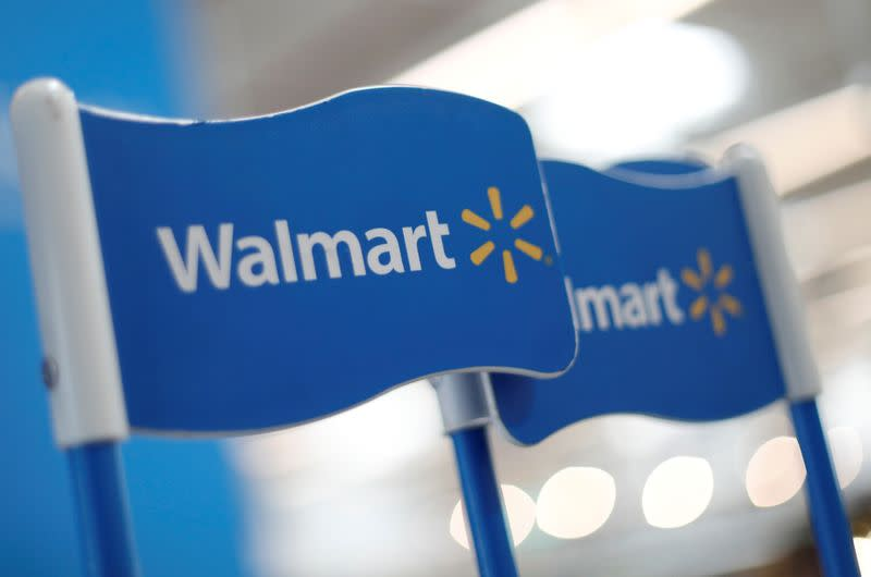 Walmart signs are displayed inside a Walmart store in Mexico City