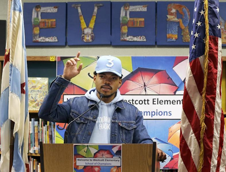 Chance The Rapper announces a gift of $1 million to the Chicago Public School Foundation during a news conference at the Westcott Elementary School, Monday, March 6, 2017, in Chicago. The Grammy-winning artist is calling on Illinois Gov. Bruce Rauner to use executive powers to better fund Chicago Public Schools. (AP Photo/Charles Rex Arbogast)