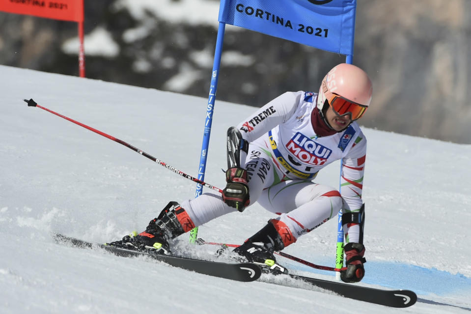 Iran's Atefeh Ahmadi speeds down the course during a women's giant slalom, at the alpine ski World Championships, in Cortina d'Ampezzo, Italy, Thursday, Feb. 18, 2021. (AP Photo/Marco Tacca)