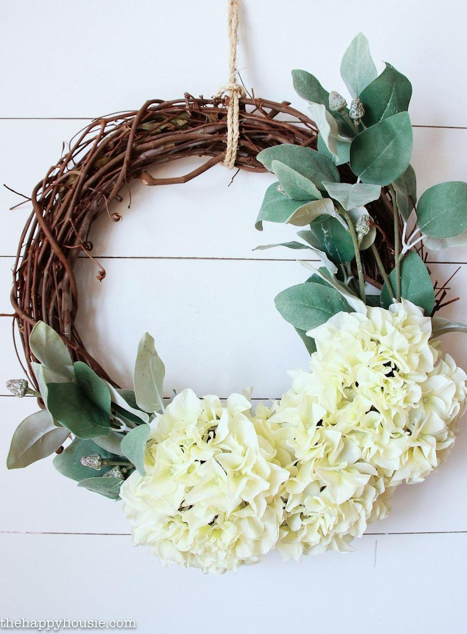 "<p>The best part about this tasteful summer wreath, aside from the gorgeous blooms? It only takes five minutes to assemble (yes, you read that correctly). </p><p><strong>Get the tutorial at <a href=""https://thehappyhousie.porch.com/five-minute-hydrangea-fall-wreath/"" rel=""nofollow noopener"" target=""_blank"" data-ylk=""slk:The Happy Housie"" class=""link rapid-noclick-resp"">The Happy Housie</a>. </strong></p><p><strong><a class=""link rapid-noclick-resp"" href=""https://www.amazon.com/Ougual-Natural-Grapevine-Wreaths-10-Inch/dp/B07K42LJPH/?tag=syn-yahoo-20&ascsubtag=%5Bartid%7C10050.g.4395%5Bsrc%7Cyahoo-us"" rel=""nofollow noopener"" target=""_blank"" data-ylk=""slk:SHOP GRAPEVINE WREATHS"">SHOP GRAPEVINE WREATHS</a><br></strong></p>"
