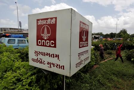 FILE PHOTO: The logo of Oil and Natural Gas Corp's (ONGC) is pictured along a roadside in Ahmedabad