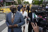 Philonise Floyd, left, brother of George Floyd, departs after participating in an interview with broadcaster Roland Martin at Black Lives Matter Plaza near the White House in Washington, Tuesday, May 25, 2021. (AP Photo/Patrick Semansky)