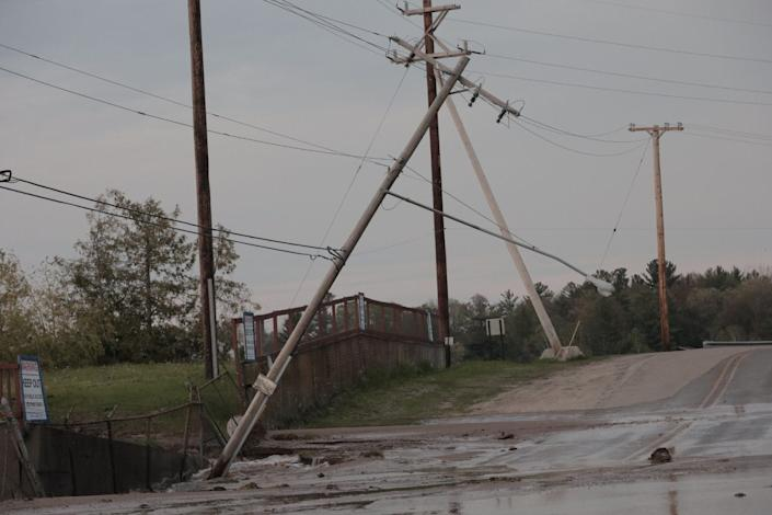 Damaged utility poles are seen during flooding in downtown Sanford, Michigan, in this May 19, 2020, picture obtained from social media.