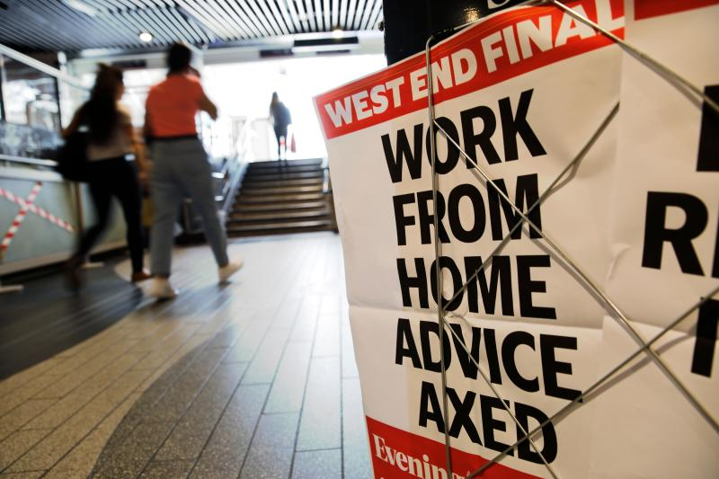 "An advertising board for the Evening Standard newspaper carries the hadline 'work from home advice axed' in London on July 17, 2020. - Boris Johnson said on July 17 he hoped Britain would ""return to normality"" by November despite being badly affected by the coronavirus and predictions of a second wave of cases during winter months. Johnson sketched out a timetable for easing the remaining lockdown measures in England, including lifting homeworking guidance and reopening sports stadiums and live theatre. (Photo by Tolga AKMEN / AFP) (Photo by TOLGA AKMEN/AFP via Getty Images)"