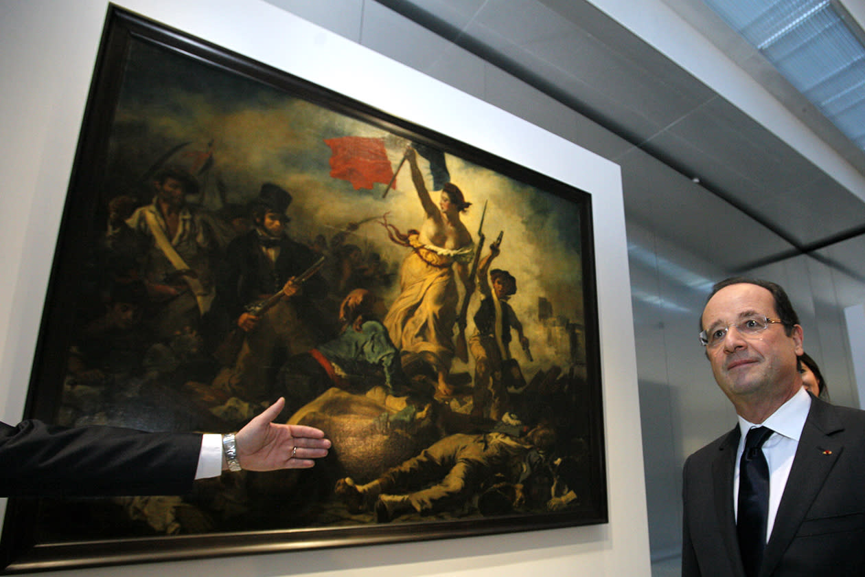 "France's President Francois Hollande is seen in front of "" La Liberte Guidant le Peuple"", a painting by Eugene Delacroix during the inauguration of the Louvre Museum in Lens."