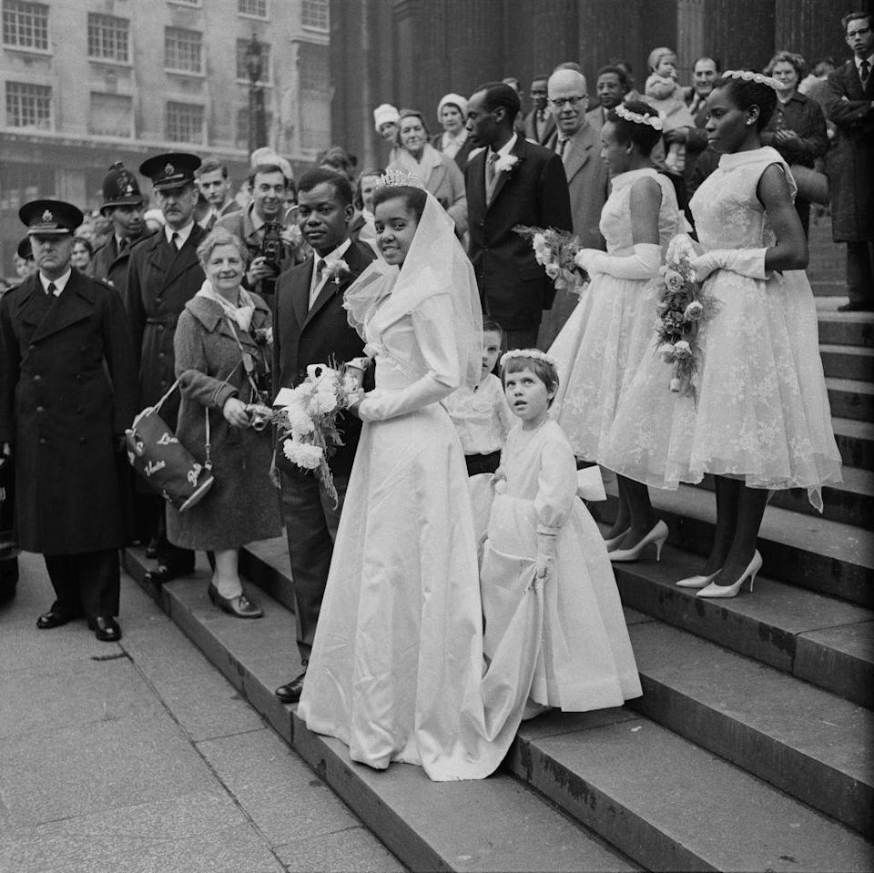 <p>The 1960s were all about the modern and shorter look. High neck collars and sleeveless dresses, like the ones seen on these bridesmaids, were popular styles of the moment. </p>