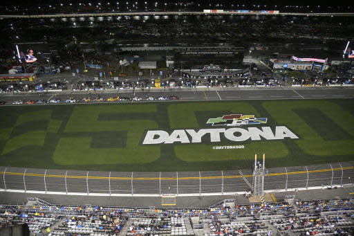 Drivers stop on pit road as rain begins falling before the first of two Daytona 500 qualifying auto races at Daytona International Speedway, Thursday, Feb. 13, 2020, in Daytona Beach, Fla. (AP Photo/Phelan M. Ebenhack)