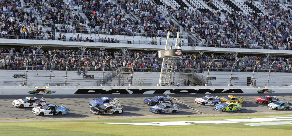 Ryan Newman (6) and Brad Keselowski (2) lead the field on a restart to resume the NASCAR Daytona 500 auto race at Daytona International Speedway, Monday, Feb. 17, 2020, in Daytona Beach, Fla. Sunday's race was postponed because of rain. (AP Photo/John Raoux)