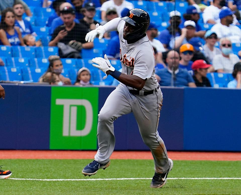 Tigers right fielder Daz Cameron scores against the Blue Jays in the 11th inning at Rogers Centre on Sunday, Aug. 22, 2021.