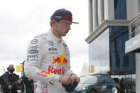 Red Bull driver Max Verstappen of the Netherlands walks from his car after qualifying Sunday's Formula One Turkish Grand Prix at the Intercity Istanbul Park circuit in Istanbul, Turkey, Saturday, Oct. 9, 2021. Verstappen will start in second place after Mercedes driver Lewis Hamilton of Britain who was fastest was give a 10 place penalty with Hamiton';s teammate Mercedes driver Valtteri Bottas of Finland now on pole. (Umit Bektas/Pool Photo via AP)