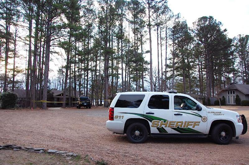 Yellow crime-scene tape blocks off the home of Mindy McCready in Heber Springs, Ark., on Monday, Feb. 18, 2013. The country singer was found dead there Sunday in an apparent suicide. She was 37. (AP Photo/Jeannie Nuss)